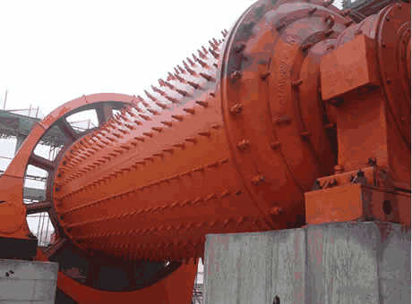 Ball mill with energizing body on the wearing plate